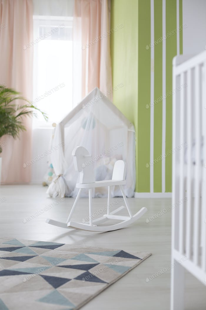 Rocking horse in baby room