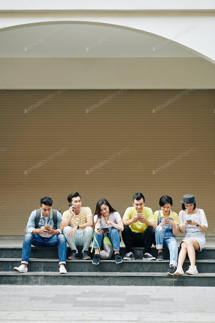 Young people checking social media