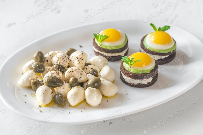 Appetizer with canape, mozzarella and capers