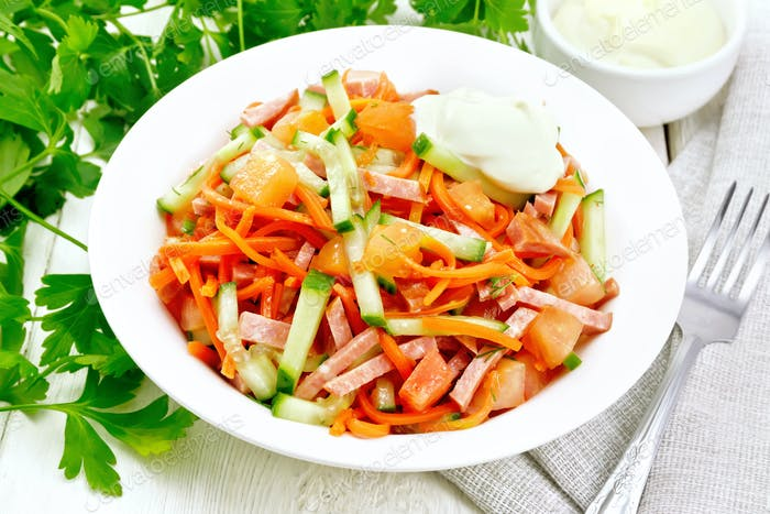 Salad of sausage and spicy carrots on board
