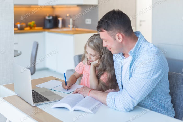 Young family doing homework