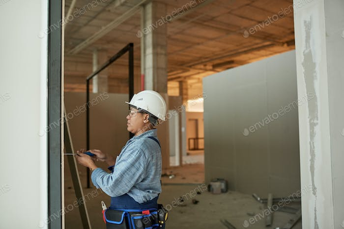 Mixed-Race Female Worker Building Wall