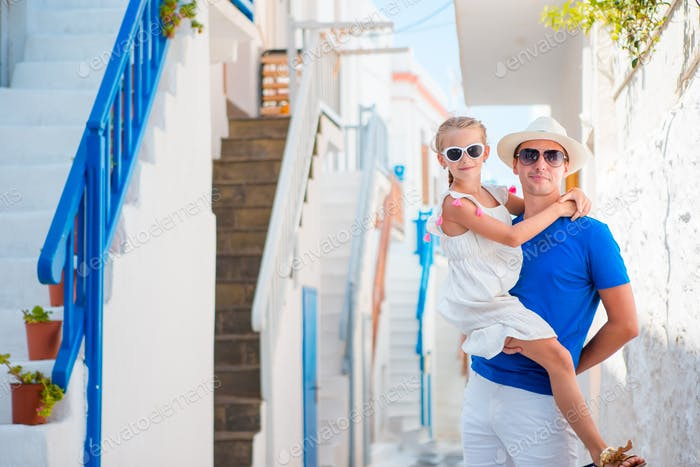 Family in Europe. Happy father and little adorable girl during summer greek vacation