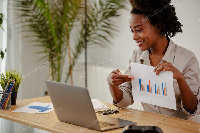 Businesswoman is presenting the results of the survey to their colleagues in an online meeting.