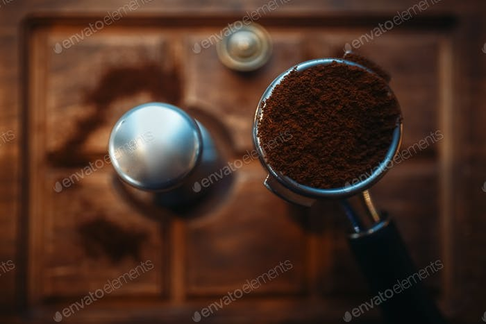 Turk with fresh ground coffee on wooden counter
