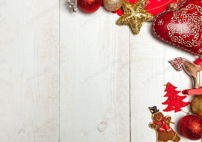 Christmas frame on white wood background.