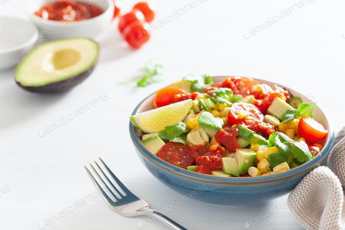 healthy vegan avocado sweetcorn tomato salad