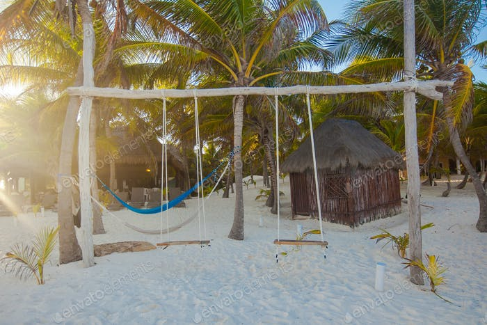 Simple wooden swing in a nice hotel on an exotic beach