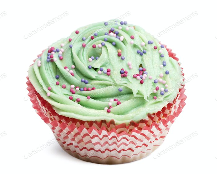 Cupcake with green icing and hundreds and thousands