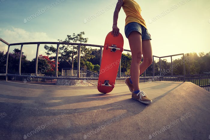 Young woman skateboarder at skatepark