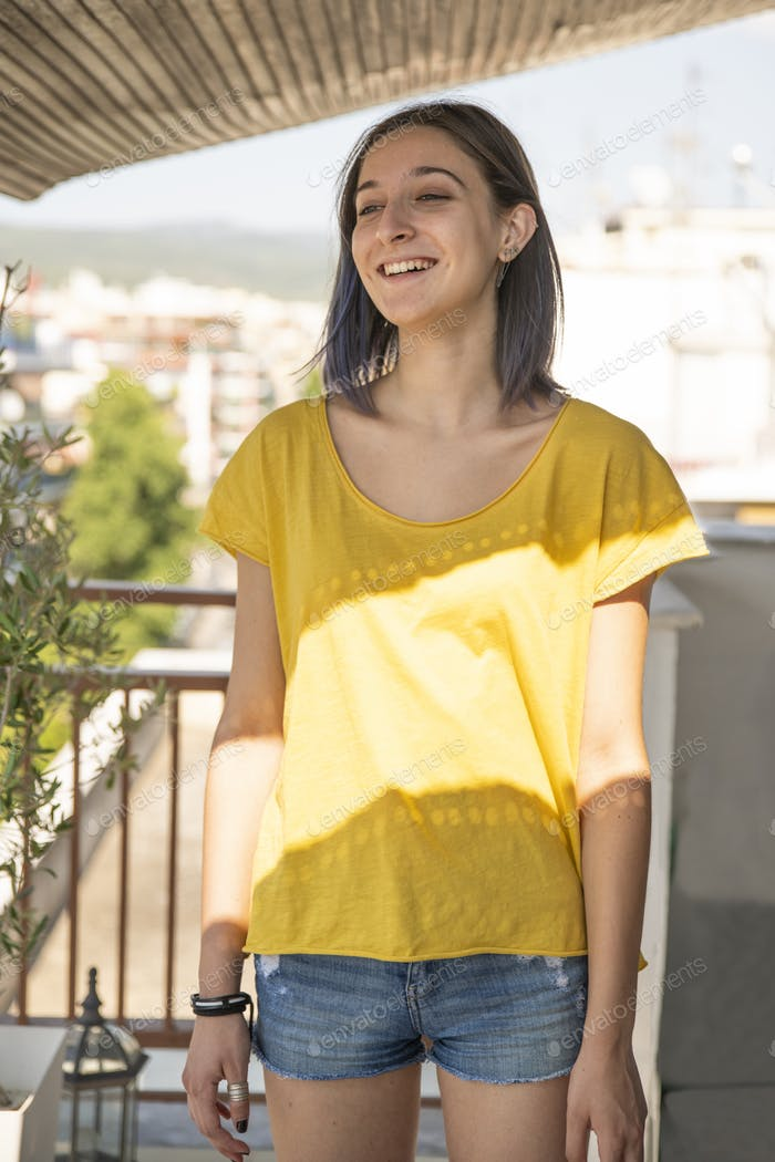 Placeit - Portrait of a Teenage Girl Smiling at the Balcony