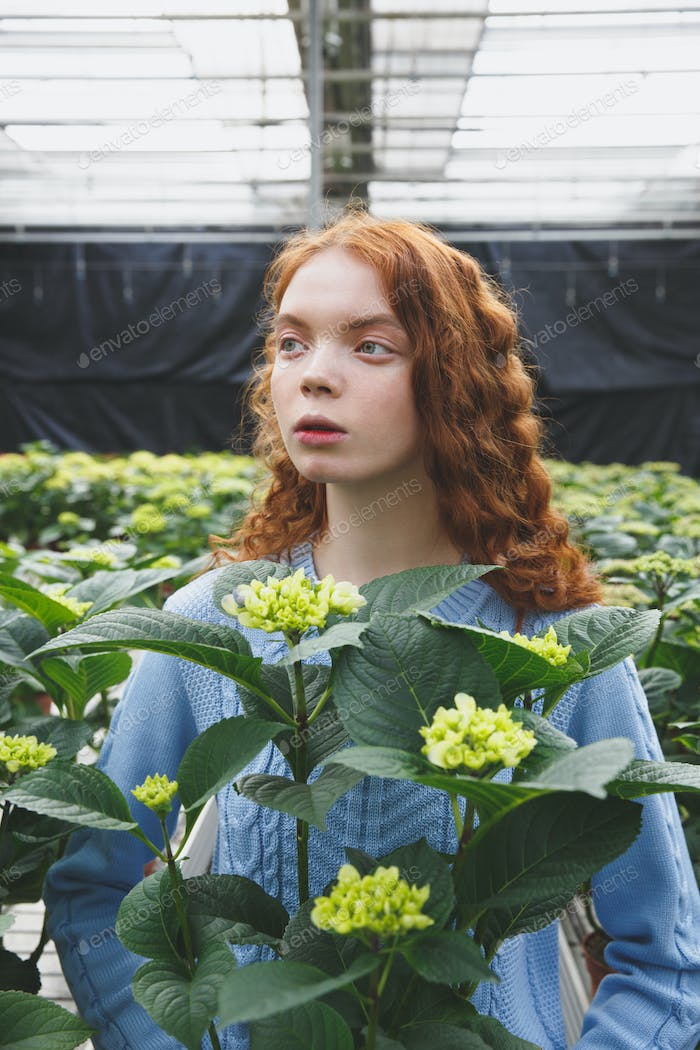 Girl with green plant