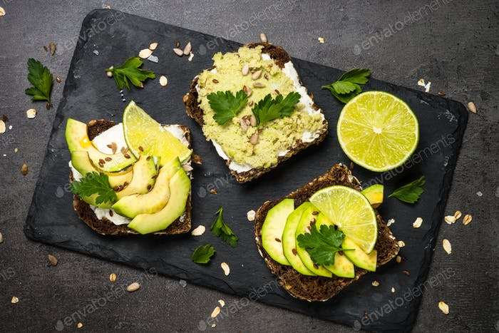 Sandwiches with avocado on black