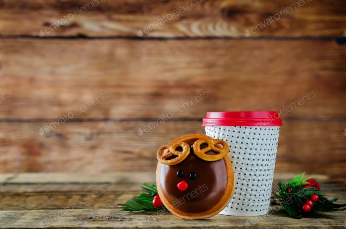 Donut with coffee on a wood background