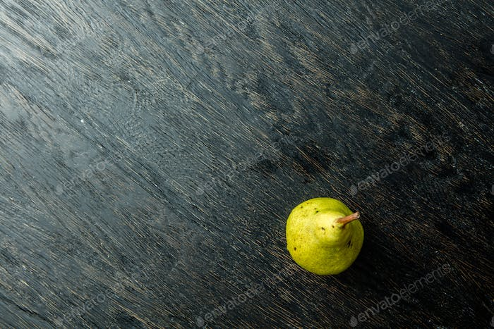 one juicy and ripe pear on a black background.
