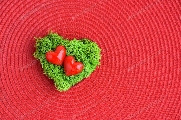 Valentines Day background with hearts. Hearts in green moss on r