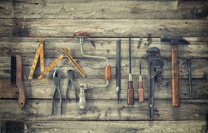Antique Tools on Rough Wood Surface