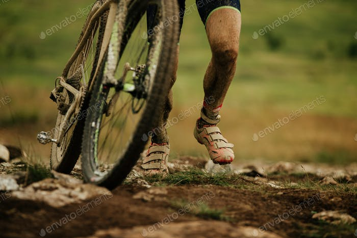 dirty feet cyclist uphill walk