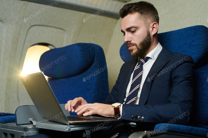 Businessman Working in Plane