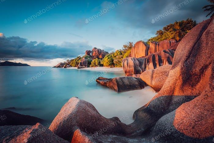 Unique shaped granite boulders and a dramatic sunset at Anse Source d'Argent beach, La Digue