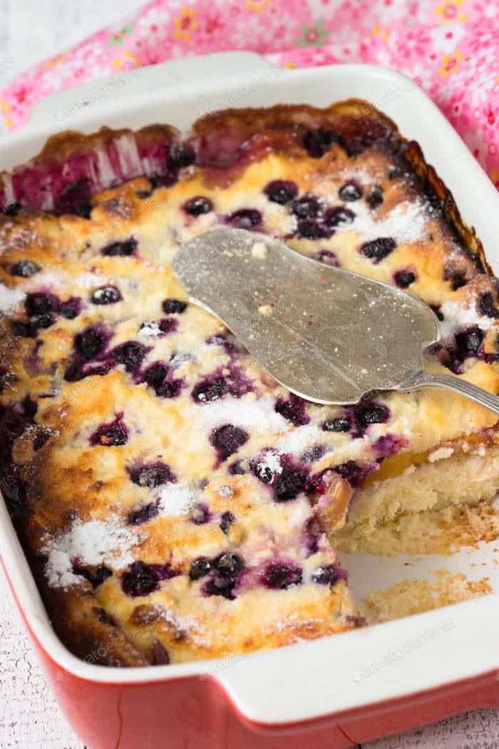 Cottage cheese casserole with peach and blueberry.