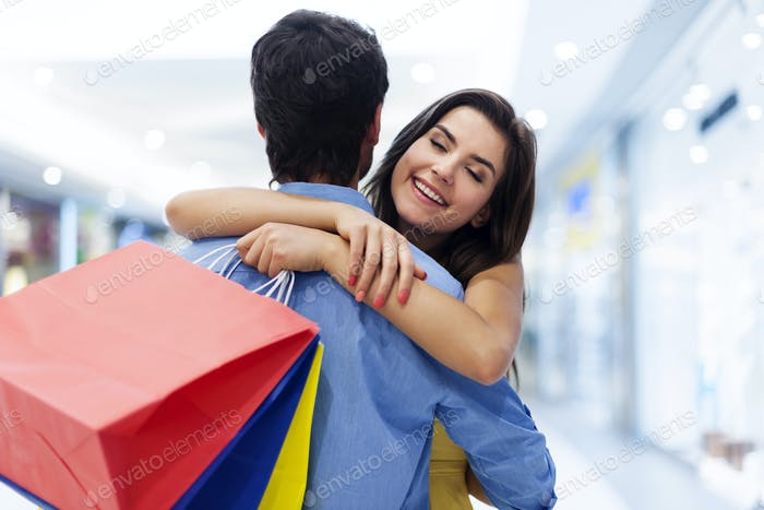 Young beautiful woman welcoming in shopping mall