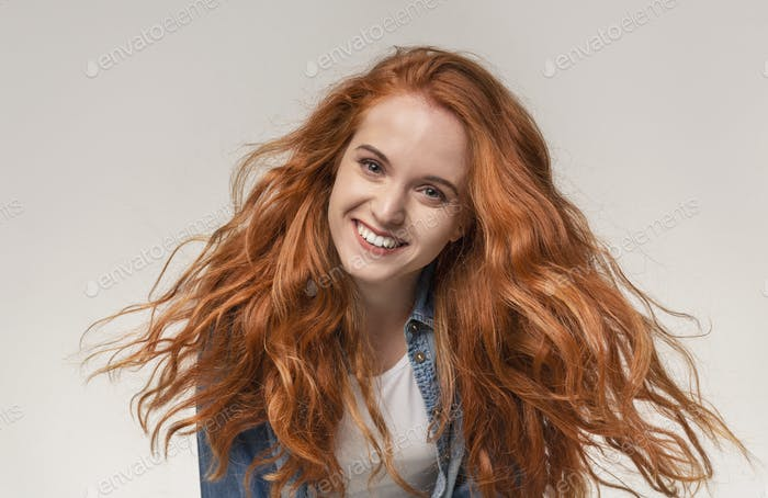 Closeup portrait of beautiful redhead girl smiling