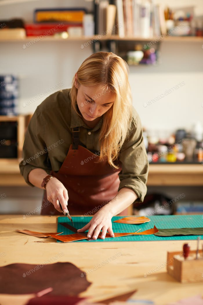 Tailor Working with Leather