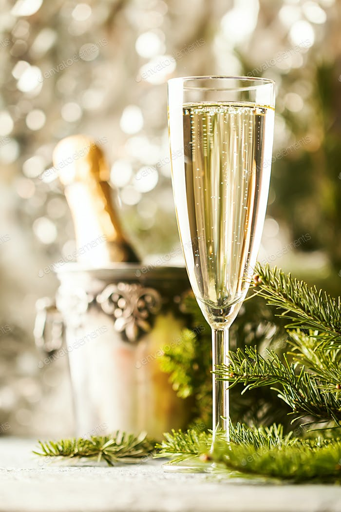 Champagne on sparkling background