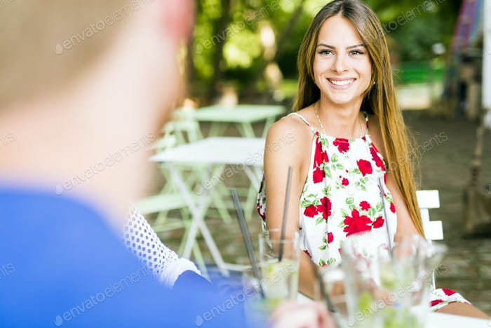 Beautiful woman and a handsome man flirting dating