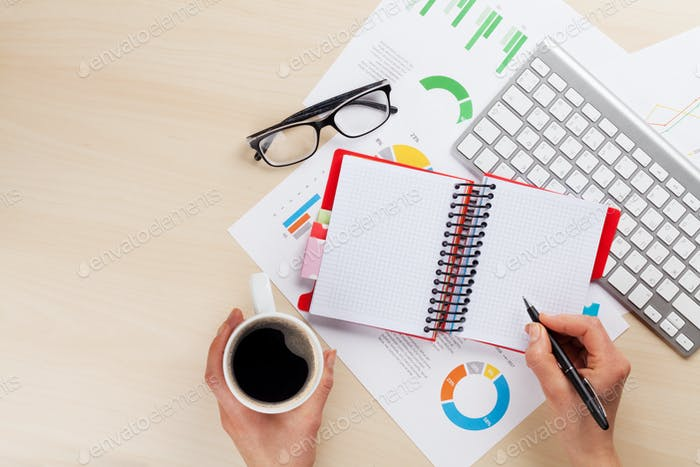 Woman working with reports and charts