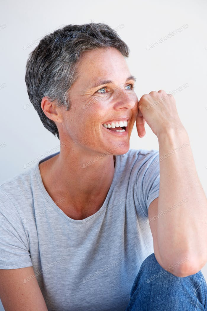 Close up relaxed older woman smiling