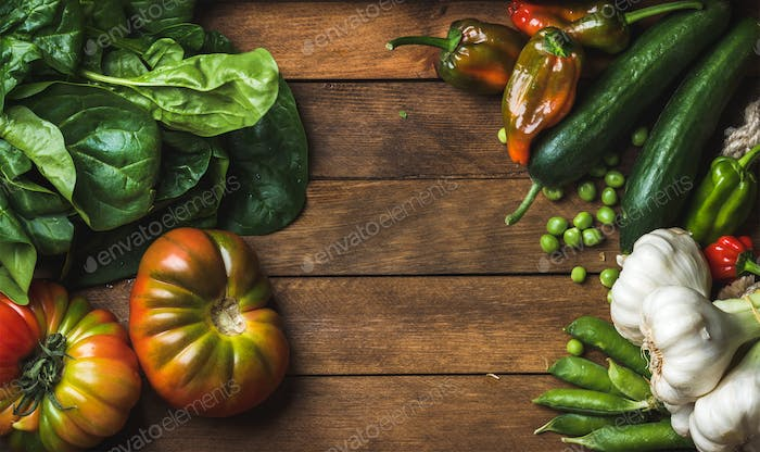 Fresh raw vegetable ingredients for healthy cooking or salad making on wooden background