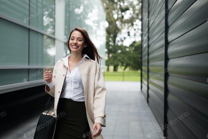 Beautiful businesswoman walking outside