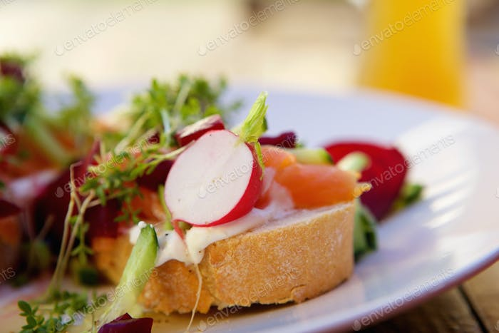 Fresh salad with smoked salmon on bread