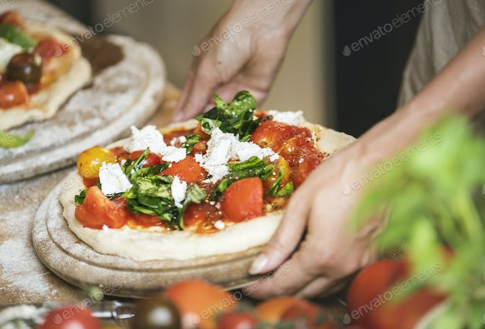 Person serving a homemade pizza