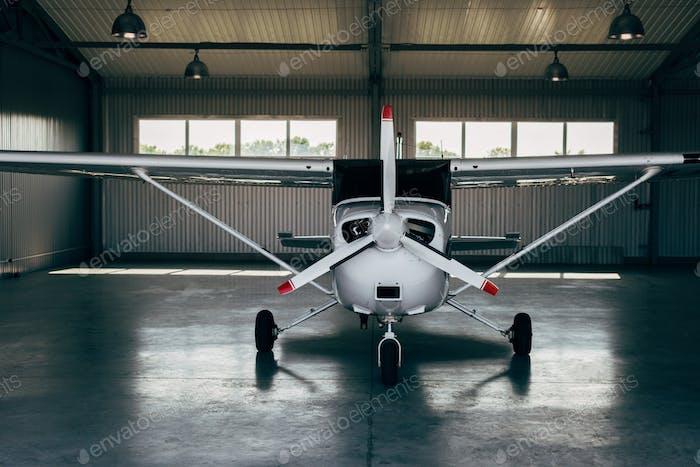 modern small airplane standing in hangar