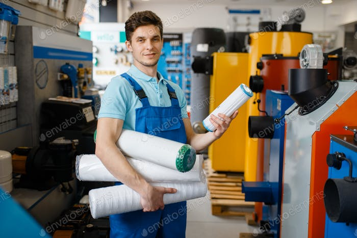 Plumber posing at the showcase, plumbering store