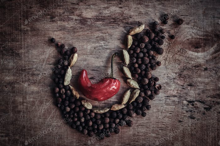 The composition of the fruits of black pepper, beans and one red pepper in the middle