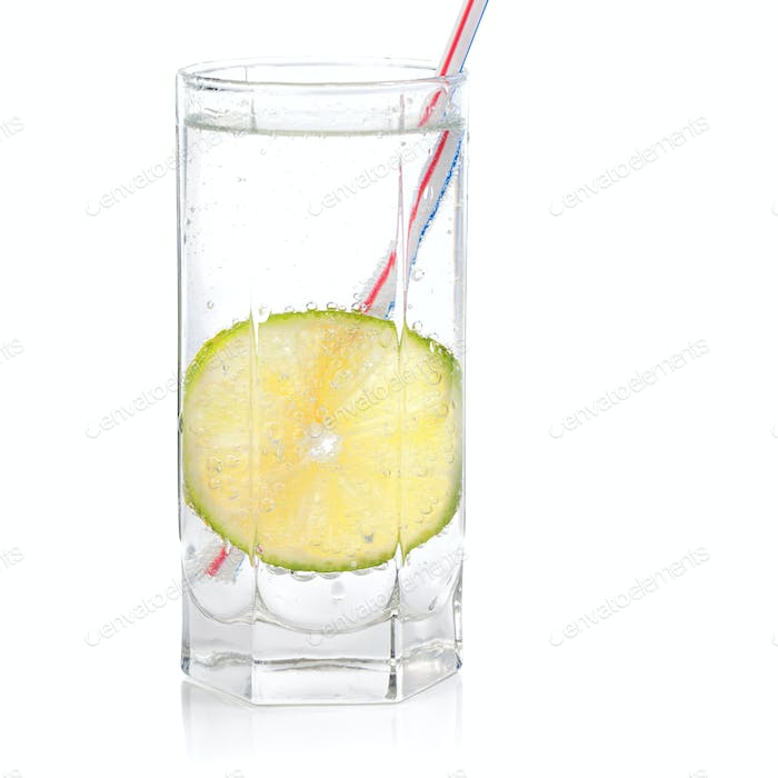 Glass with water and a lime slice.