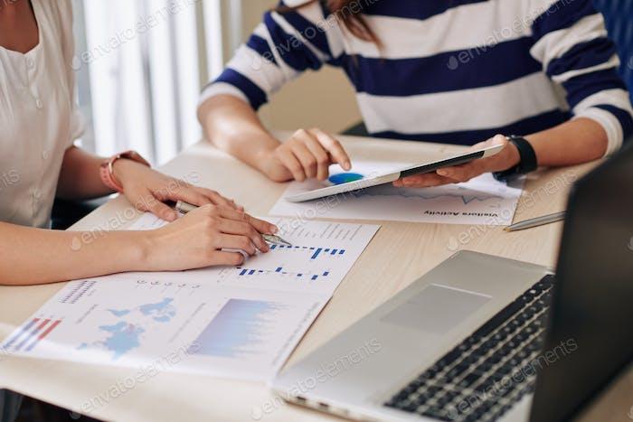 Businesswomen analyzing financial charts