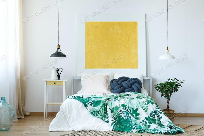 Yellow painting in bedroom