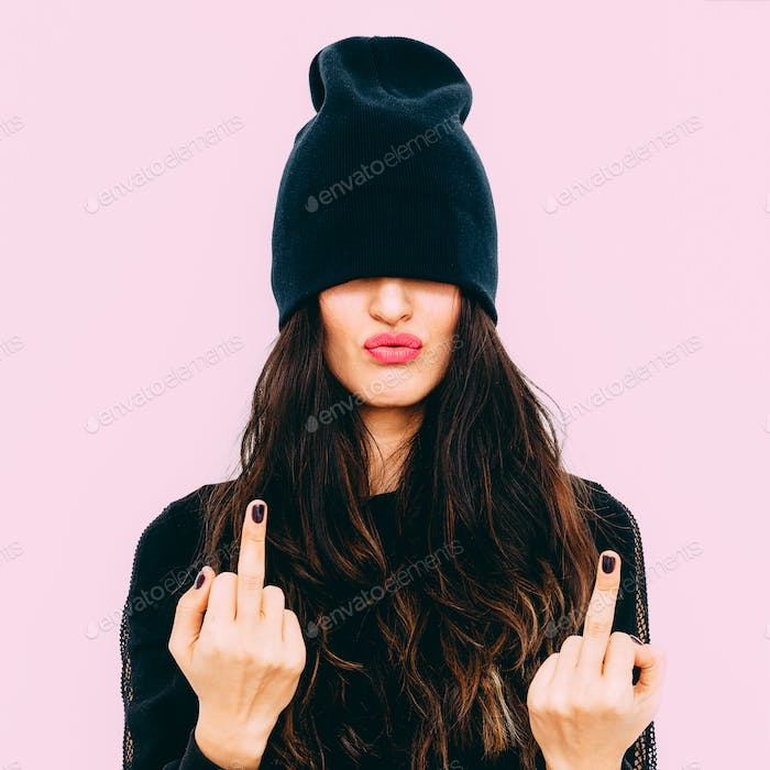 Aggressive brunette in fashion black clothes. Urban Swag style