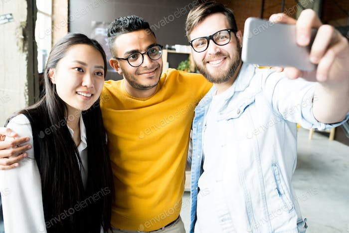 Multi-Ethnic Group  of Young  People Taking Selfie