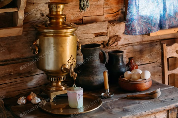 Interior of kitchen room in russian traditional wooden house in