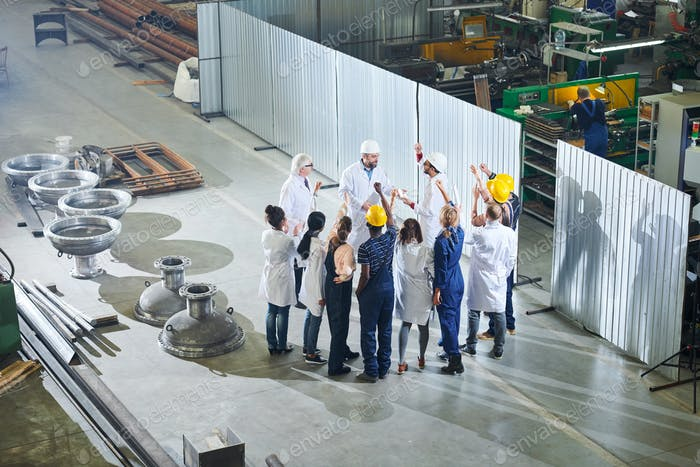 Factory Workers Meeting with Managers