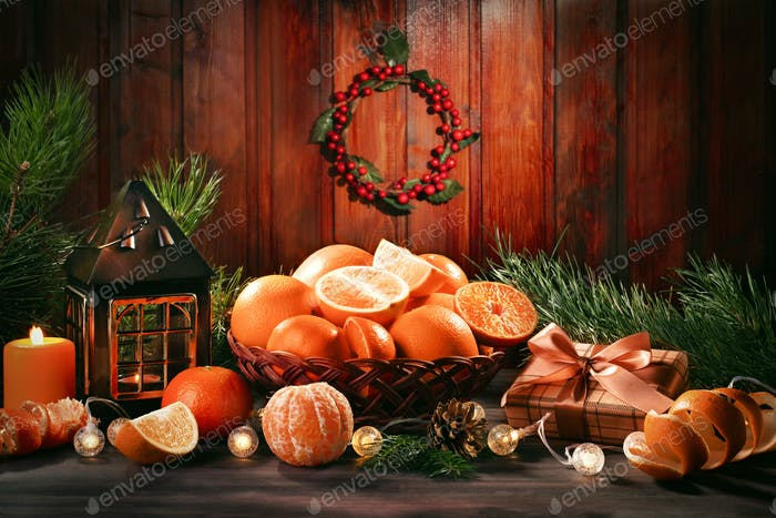 Christmas still life with oranges and lantern