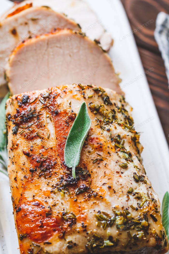 Sliced pork loin roasted . Recipe with herbs.