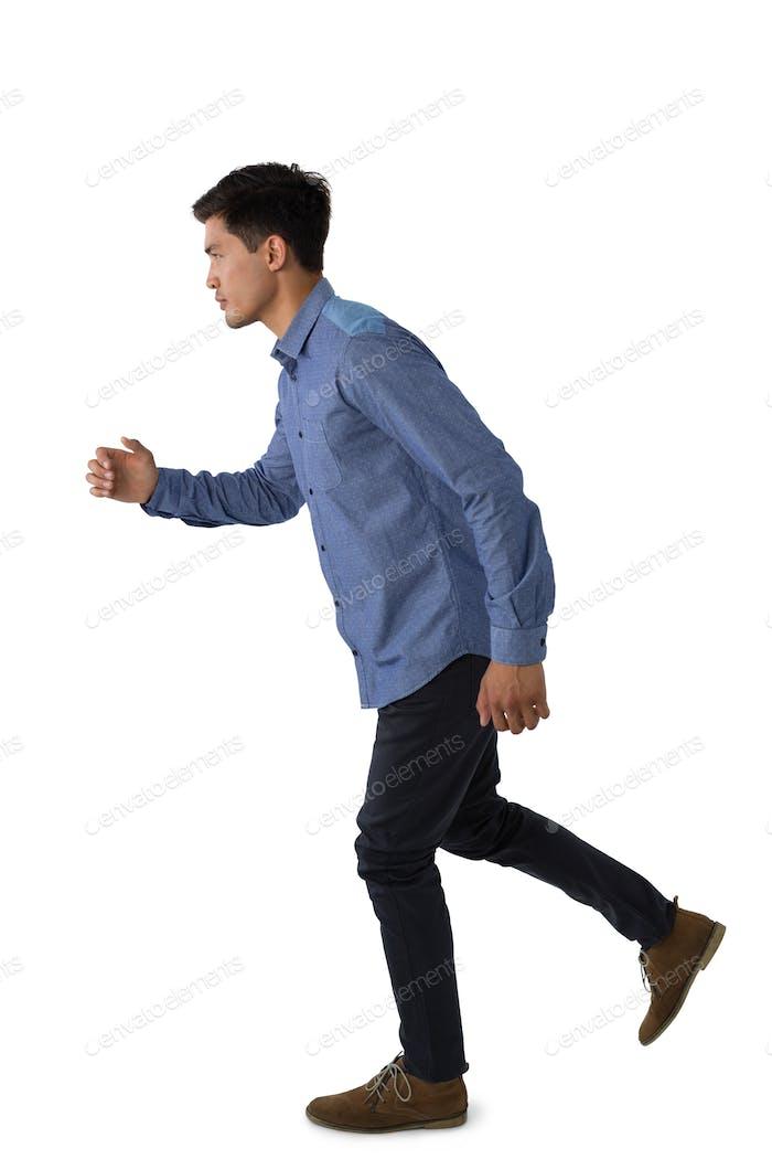 Full length of businessman running