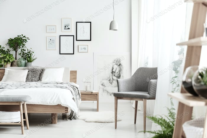 Grey chair in bright bedroom